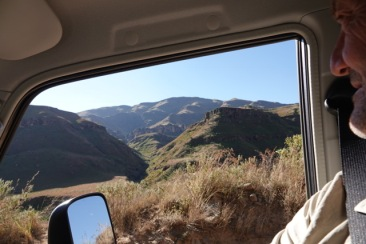The Drakensberg Mountains loom in the distance.